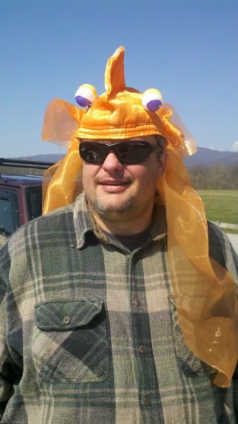 Chad Snyder tries on the headpiece, now with the eyes.