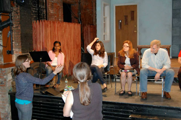 At Monday's rehearsal, on the actual stage. Director Rose Bonczek is standing, back to camera.