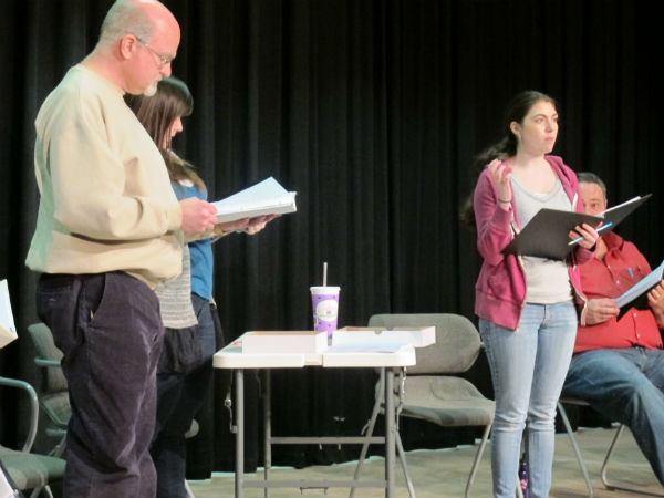 Larsen (played by Emma Sala) gets ready to throw a softball through a hornet's nest, under the glaring eye of Mr. Barnett (Patrick Kennerly), the hard-hearted science teacher and softball coach and the hopeful eye of Kristin Turner (Kelly Anglim), the soft-hearted principal who hopes the feat will show the coach the troublesome student has a gift.