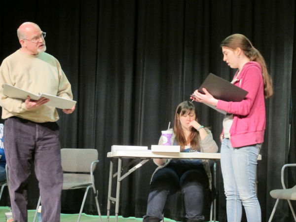 Mr. Barnett (Patrick Kennerly) confronts Larsen (Emma Sala) when he catches her trying to steal a bat from the supply closet. What he doesn't realize yet is, she wants it for self-defense against Squirrel.