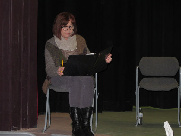 Showtimers president Vickie Haynie read stage directions.