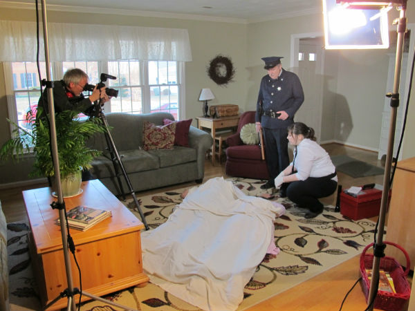 Hank Ebert (left) with Gary Reid (the police officer) and Kelly Anglim (the evidence tech) with Charlie and Martha Boswell somewhere under the sheets.