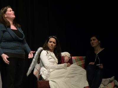 The angel decides to sit a spell. Molly, played by Kelly Weiman, doesn't see her, much to her mom's consternation.