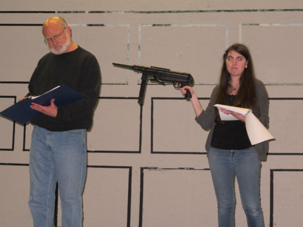 Newspaper editor Horace (Patrick Kennerly) finds himself at gunpoint from Meredith (Emma Sala.)