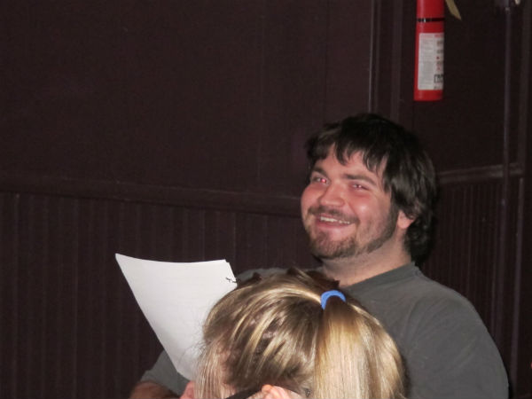 Luke Clark, who's reading stage directions, finds something funny.