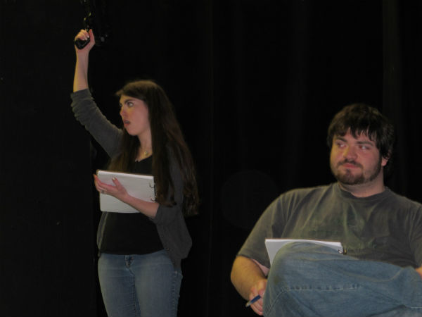 Meredith (Emma Sala) really likes her gun. That's Luke Clark reading stage directions.