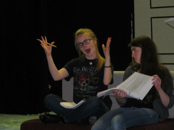 Zelda (Gwyneth Strope) reacts to her video game. Meredith (Emma Sala) is not impressed.
