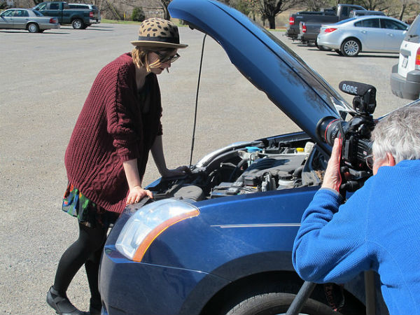 Uh-oh. Hannah Whitt has car trouble! Enough to distract even a bike thief.