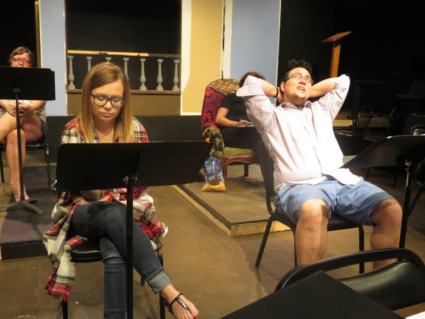 A rehearsal photo in civilian garb. Sara and Charlie wait out a tornado in the storm cellar. He's quite relaxed.