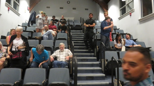 Here's some of the audience taking seats. This was in the theatre at Randolph College.