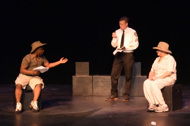 The officer interrogates the head of animal care (left) and the zoo director (right).