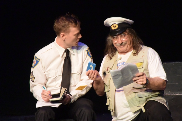 The officer with the interpreter who plays Captain Ahab.